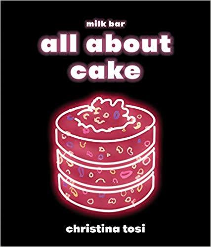 a pink illustration of a cake on a black background