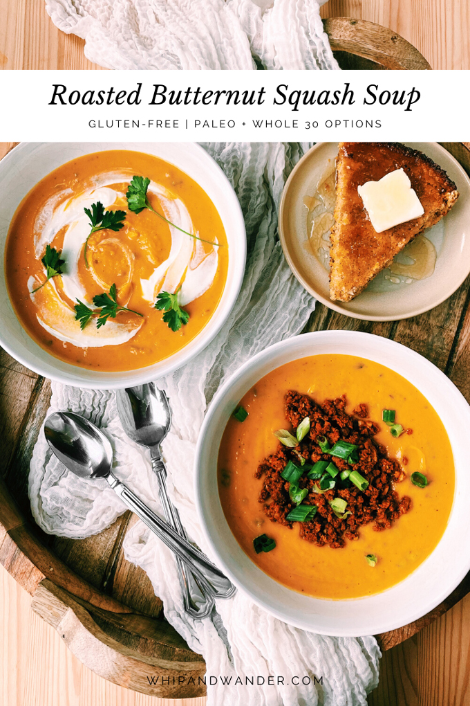 two white bowls with Roasted Butternut Squash Soup topped with herbs and onions and chorizo with spoons and cornbread on a wooden tray