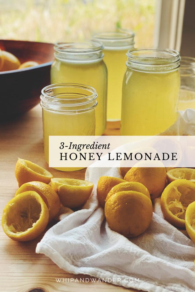 juiced lemons, jars of honeyed lemonade, and a bowl filled with whole lemons