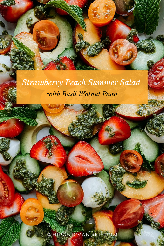 a pesto and mint topped summer salad of strawberries and peaches and vegetables
