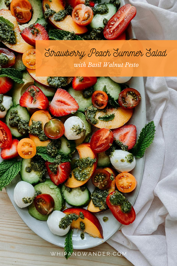 a summer salad of peaches, strawberries, mozzarella, and peso on a white dish with a white towel under the dish