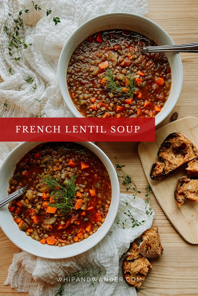 two white bowl of french lentil soup with rustic bread, resting on a wooden table