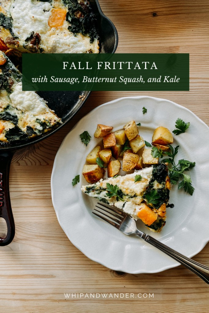 a white plate with a slie of Fall Frittata with Sausage, Butternut Squash, and Kale, roasted potatoes, and a fork resting next to a cast iron pan on a wooden surface