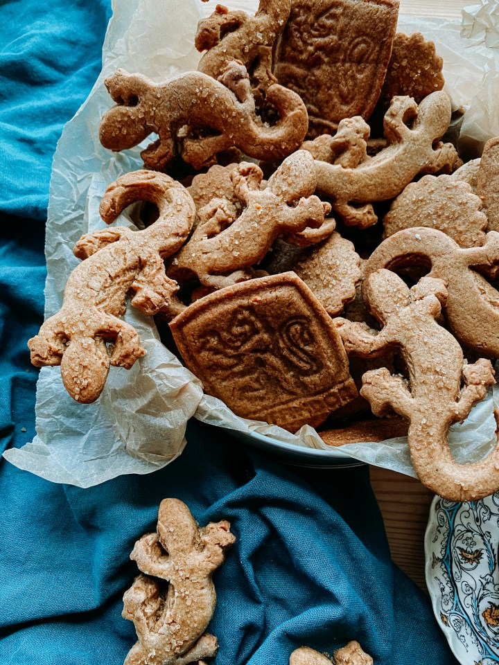 closeup of Professor McGonagall's Ginger Newt Biscuits in a parchment lined biscuit tin