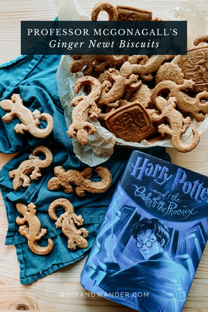 a blue harry potter book resting next to a biscuit tin of ginger cookies, several more cookies resting on a dark green blue towel under the tin
