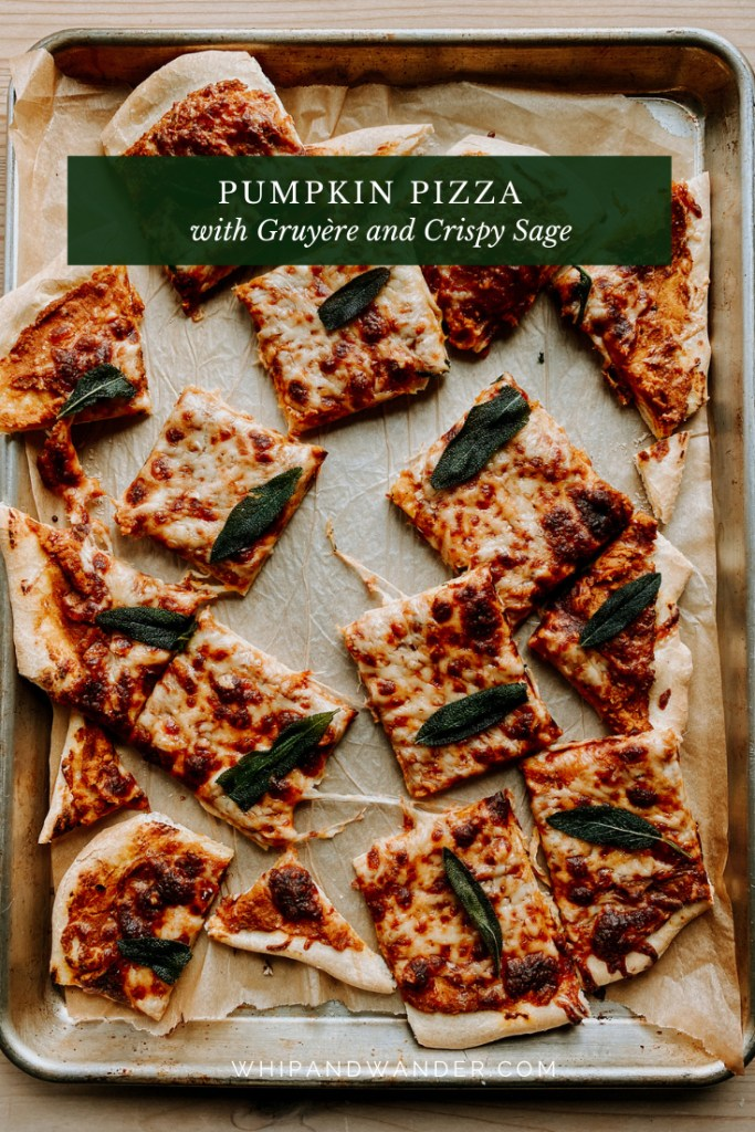 Pumpkin Pizza with Gruyere and Crispy Sage that has been sliced into squares and resting on a parchment lined baking tray