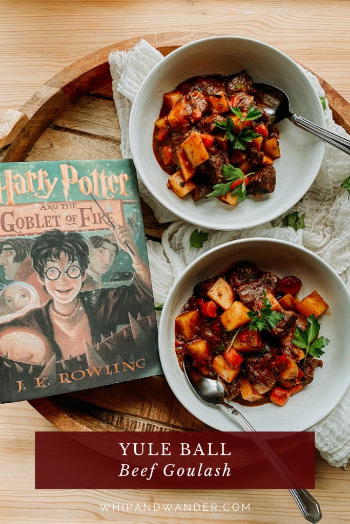 a harry potter book on a tray with two white bowls of Yule Ball Beef Goulash