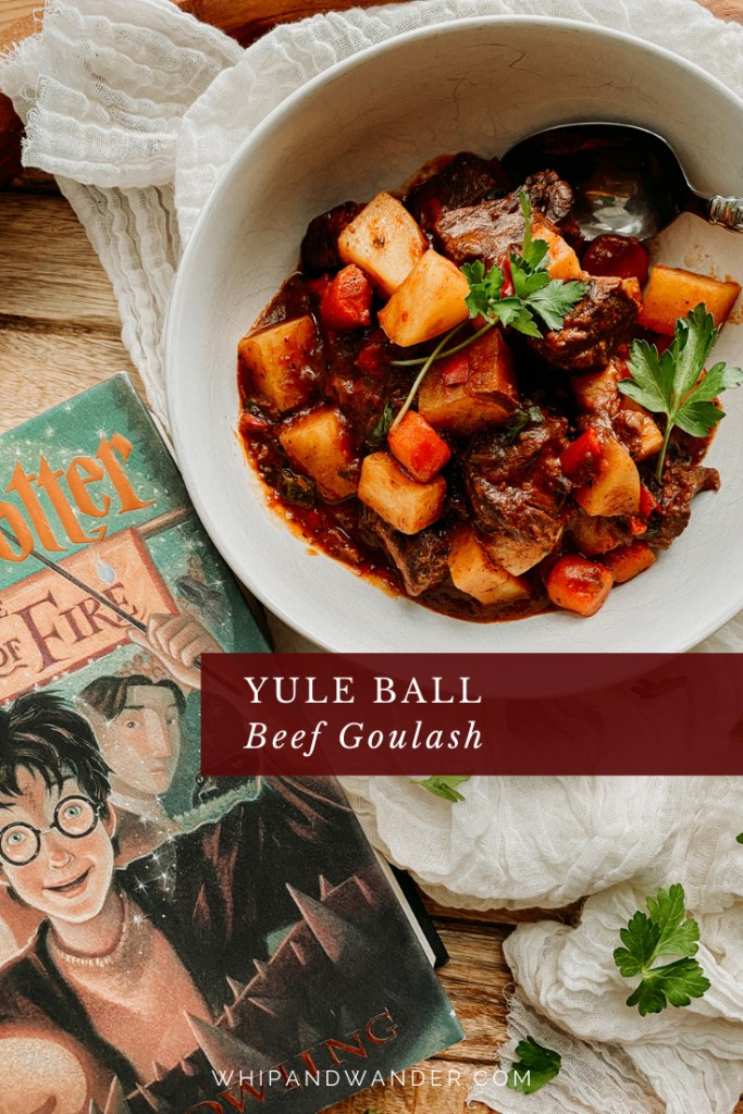 Yule Ball Beef Goulash and a harry potter book on a wooden tray with cheese cloth
