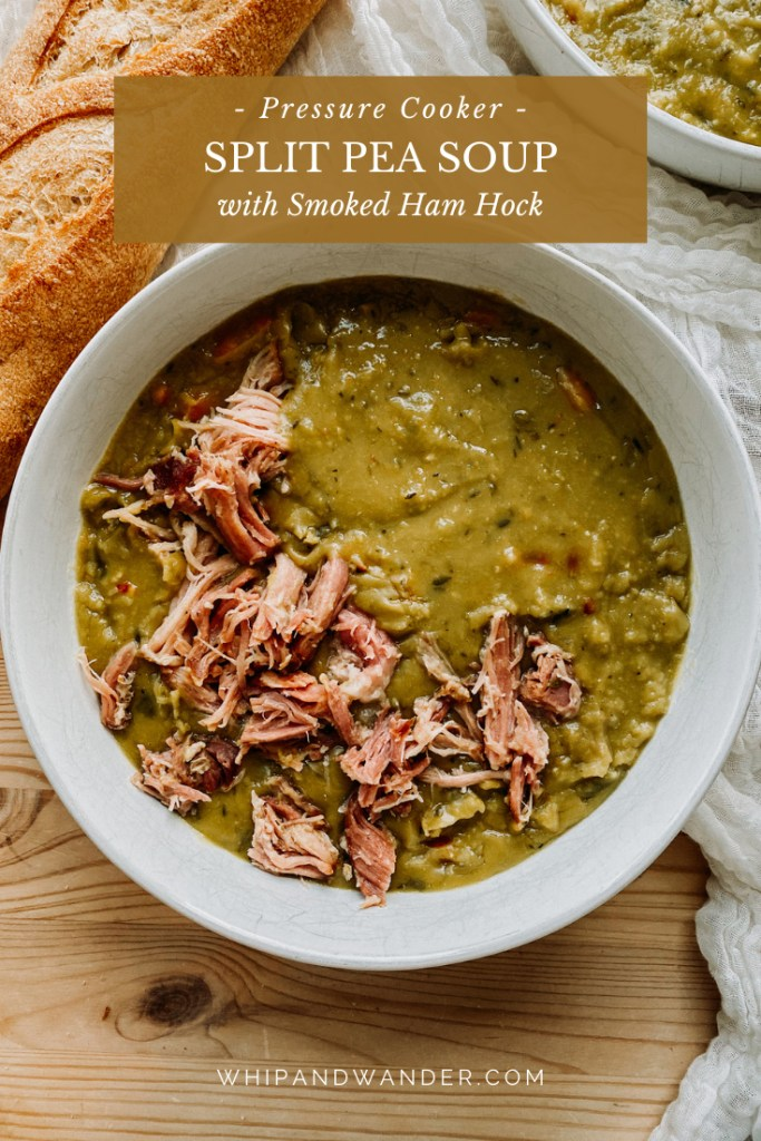 a bowl of Instant Pot Split Pea Soup with Smoked Ham Hock resting on a white fabric lined wooden surface with bread