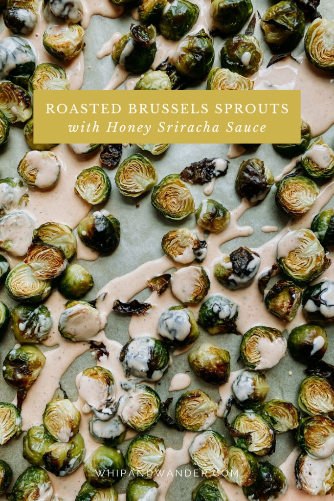 a parchment covered sheer pan with roasted brussels sprouts drizzled with honey sriracha sauce