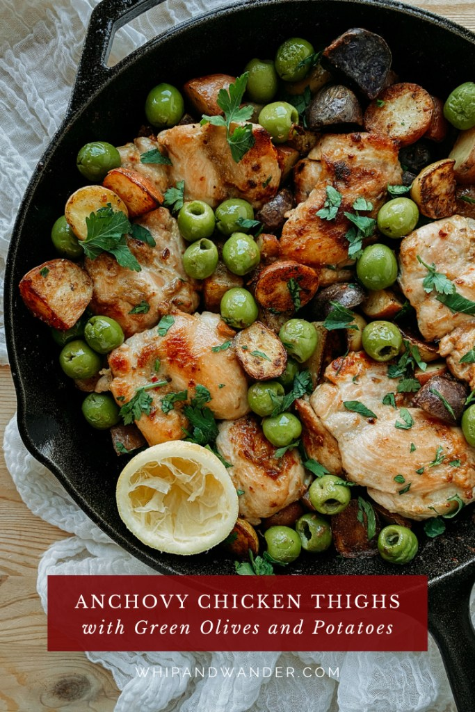 green olives, lemon, chicken, and potatoes in a cast iron skiller