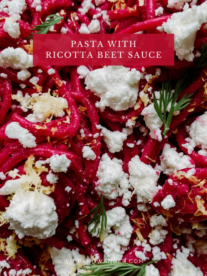 closeup of spaghetti noodles covered in ricotta beet sauce, fresh dill leaves, goat cheese, and lemon zest