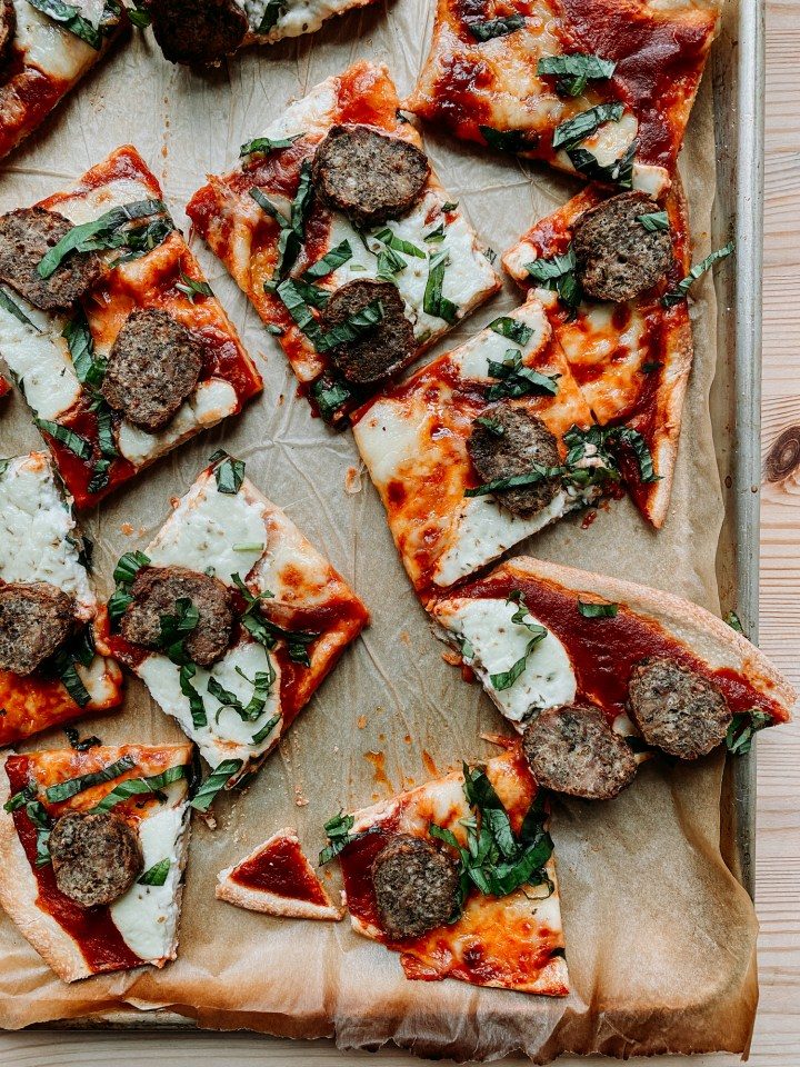 a sheet pan with slices of meatball and ricotta pizza