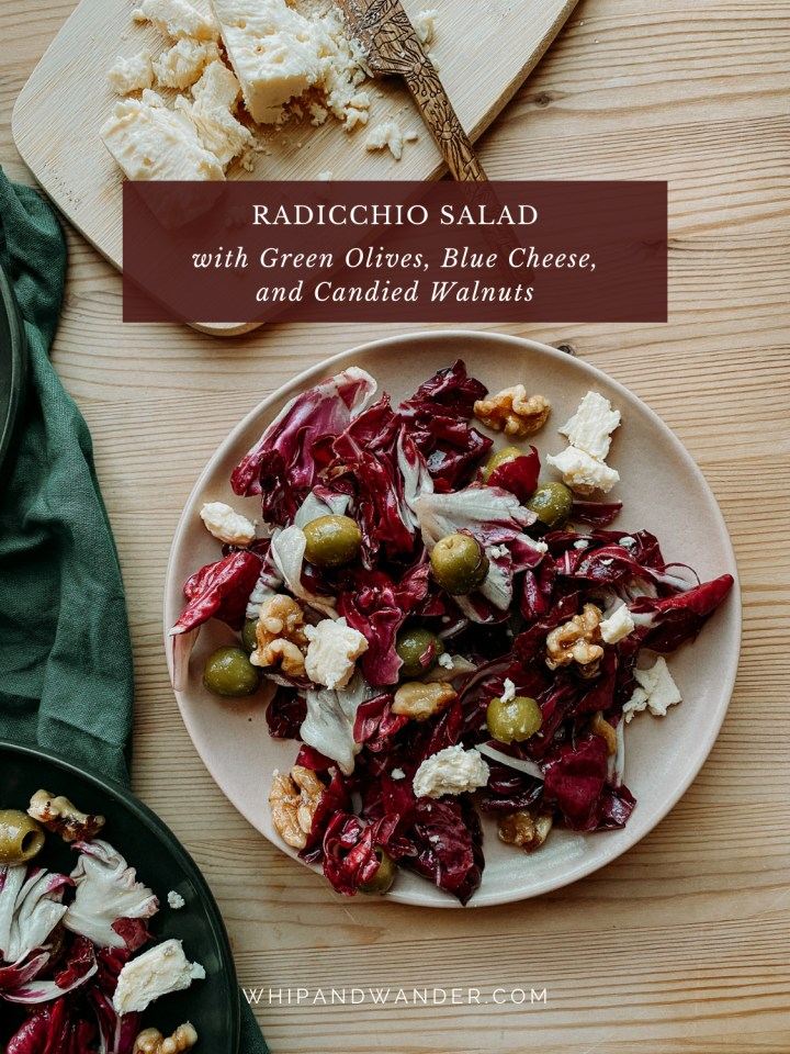 a pink salad plate covered in radicchio salad with walnuts, olives, and blue cheese