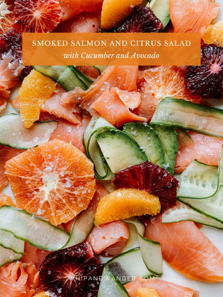 ribbons of cucumber on top of slices of citrus, slices of smoked salmon, and avocado