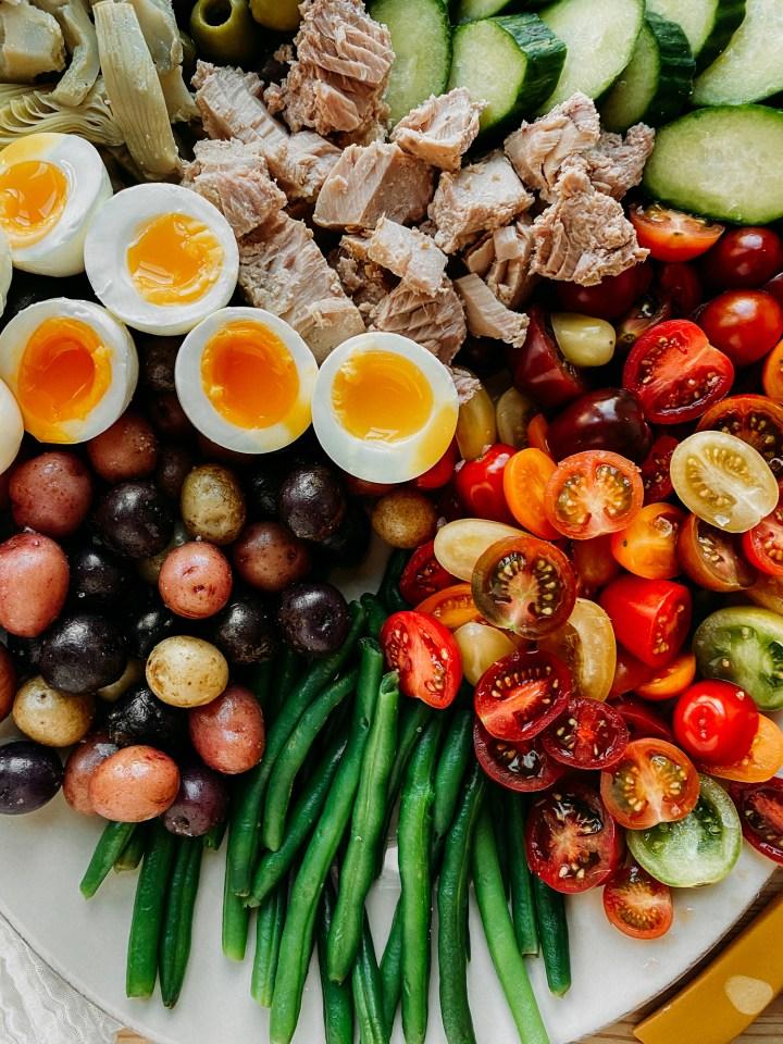 closeup of potatoes, eggs, green beans, tomatoes, and tuna