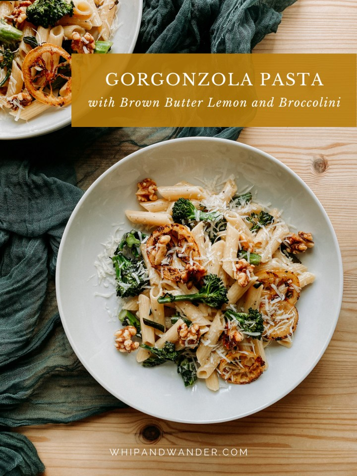 walnuts and parmesan on top of Gorgonzola Pasta with Browned Butter Lemon and Broccolini in a white bowl on a dark teal cloth