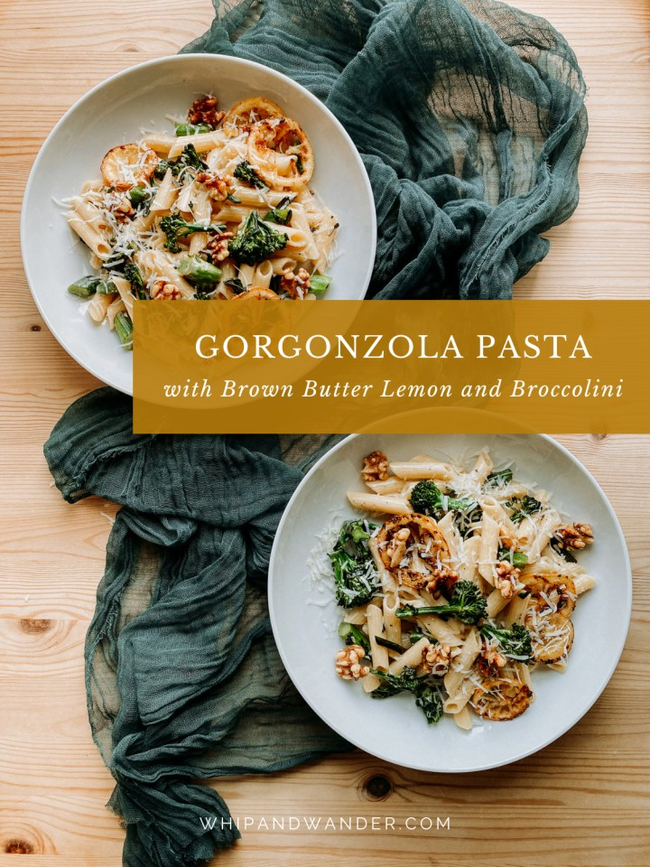 two white dishes containing gorgonzola penne pasta resting on a cloth lined wooden surface