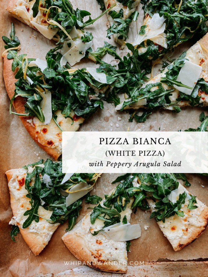 slices of pizza bianca topped with parmesan, lemon, and arugula