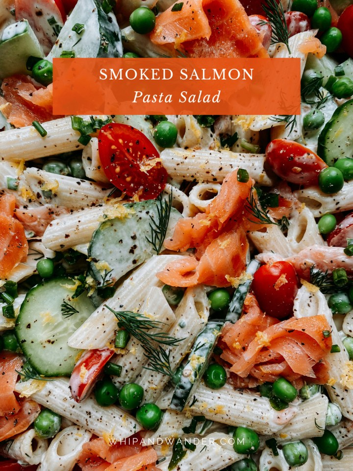 closeup of smoked salmon, penne, herbs, tomatoes, cucumbers, and peas