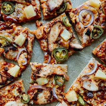 square slizes of BBQ Chicken Pizza on a sheet pan