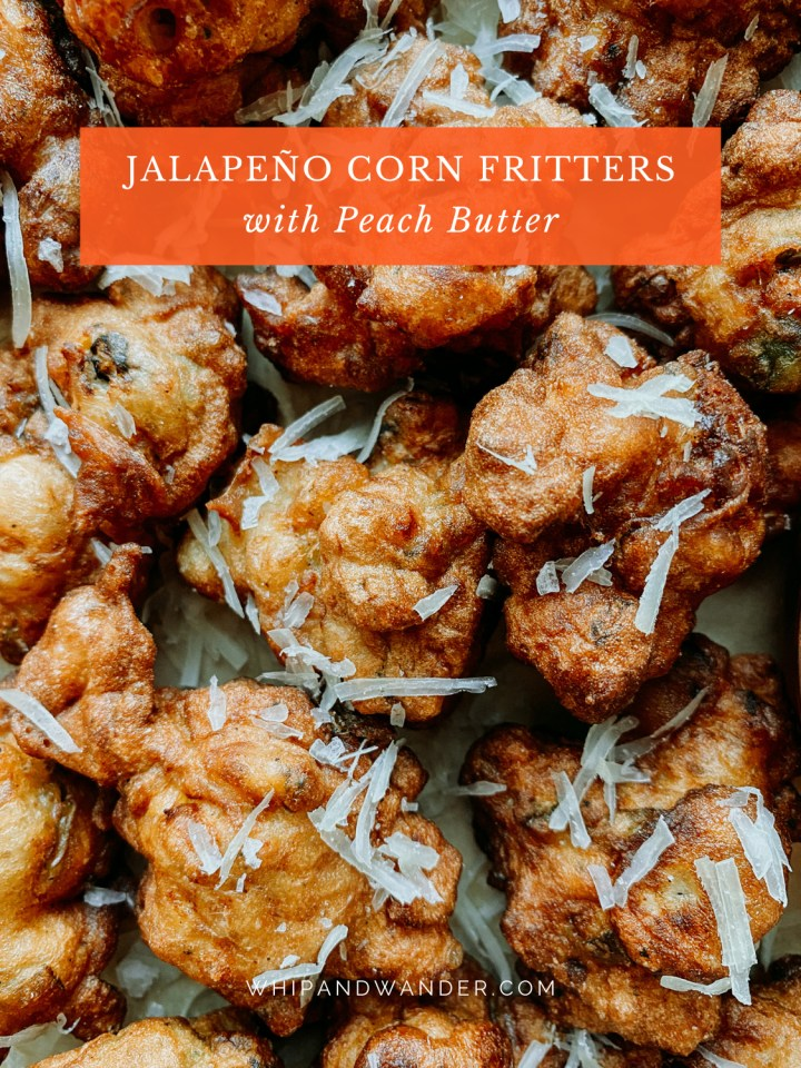 freshly fried Jalapeño Corn Fritters in a pile with parmesan on top