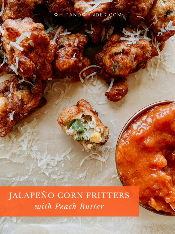 jalapeno and corn inside of a fritter resting next to some peach dip