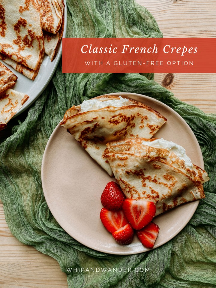 two french crepes filled with whipped cream on a pale pink plate with strawberries
