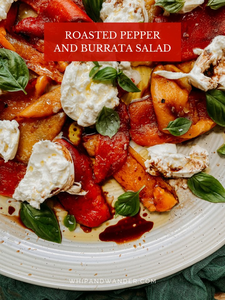 a white plate with roasted orange and red peppers, basil, and burrata