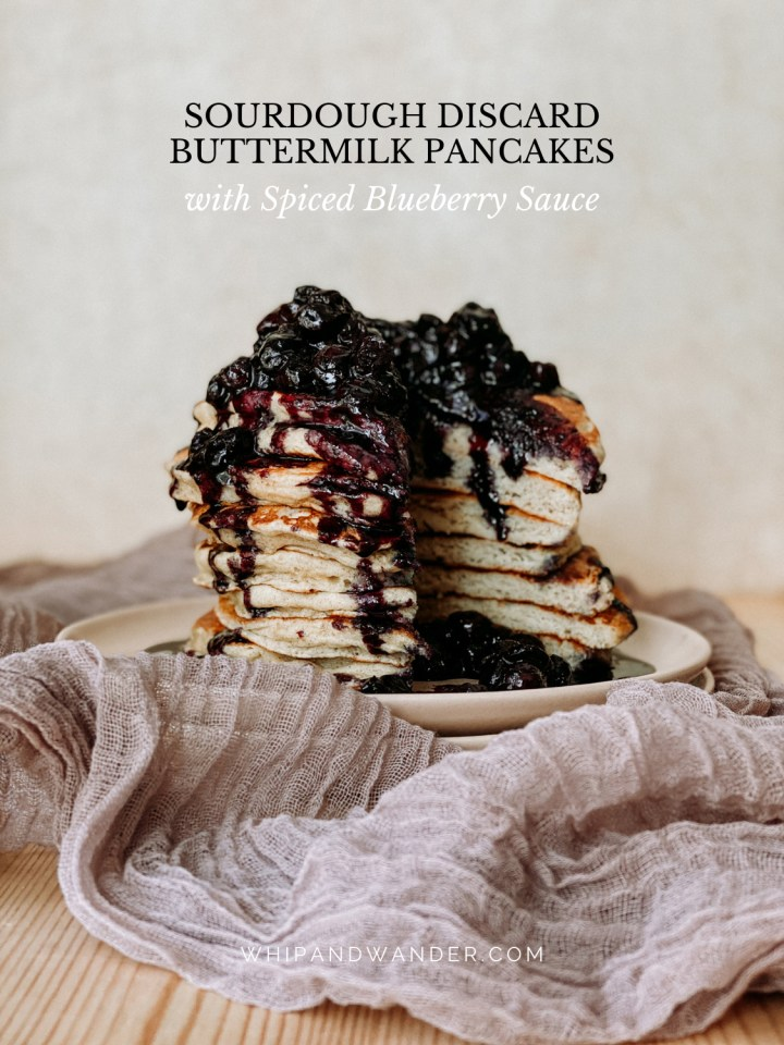 a stack of sourdough buttermilk pancakes with blueberry sauce that have been cut into