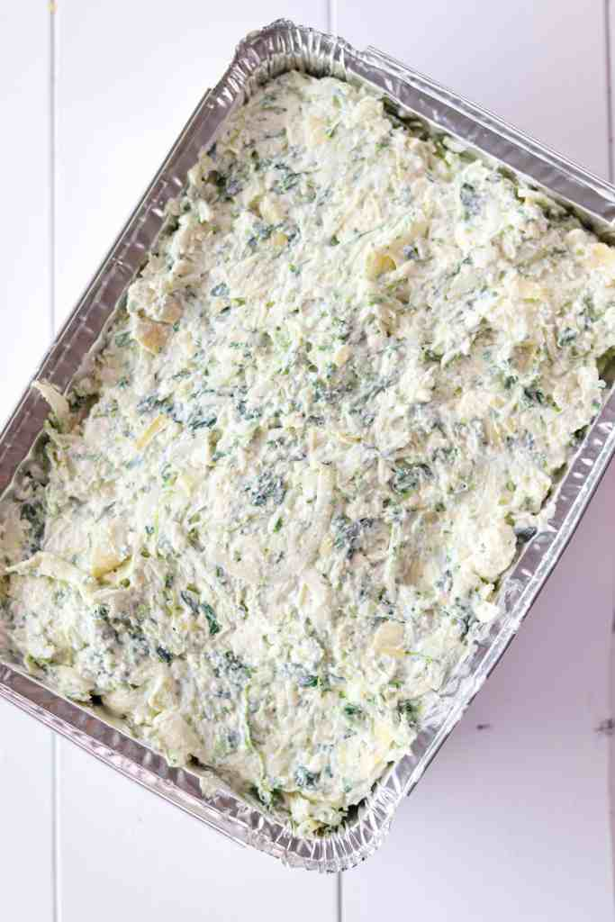 Campfire Spinach & Artichoke Dip prepared and in a container to be frozen