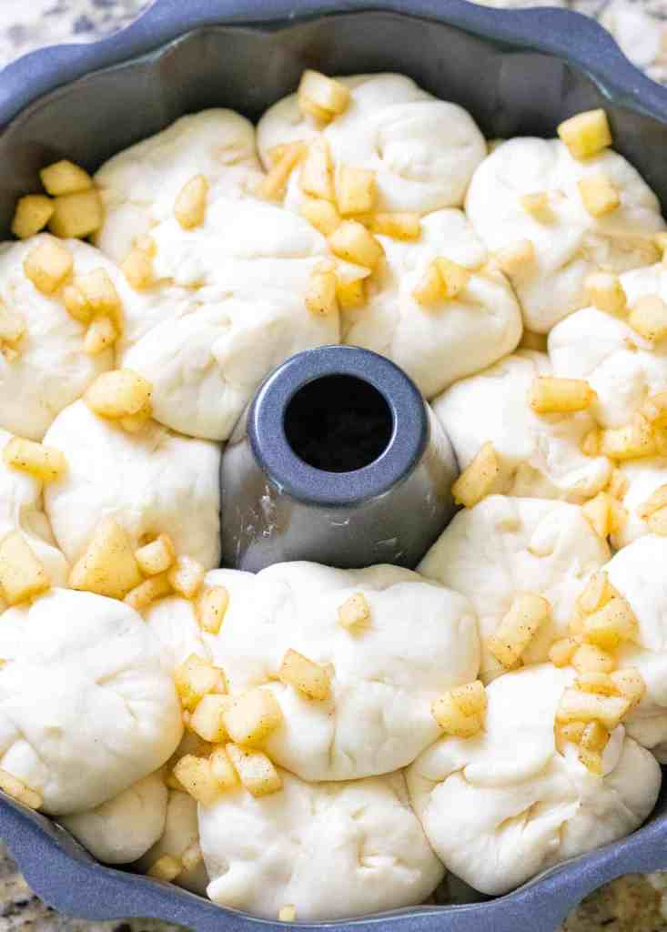 all of the dough balls in the bundt pan