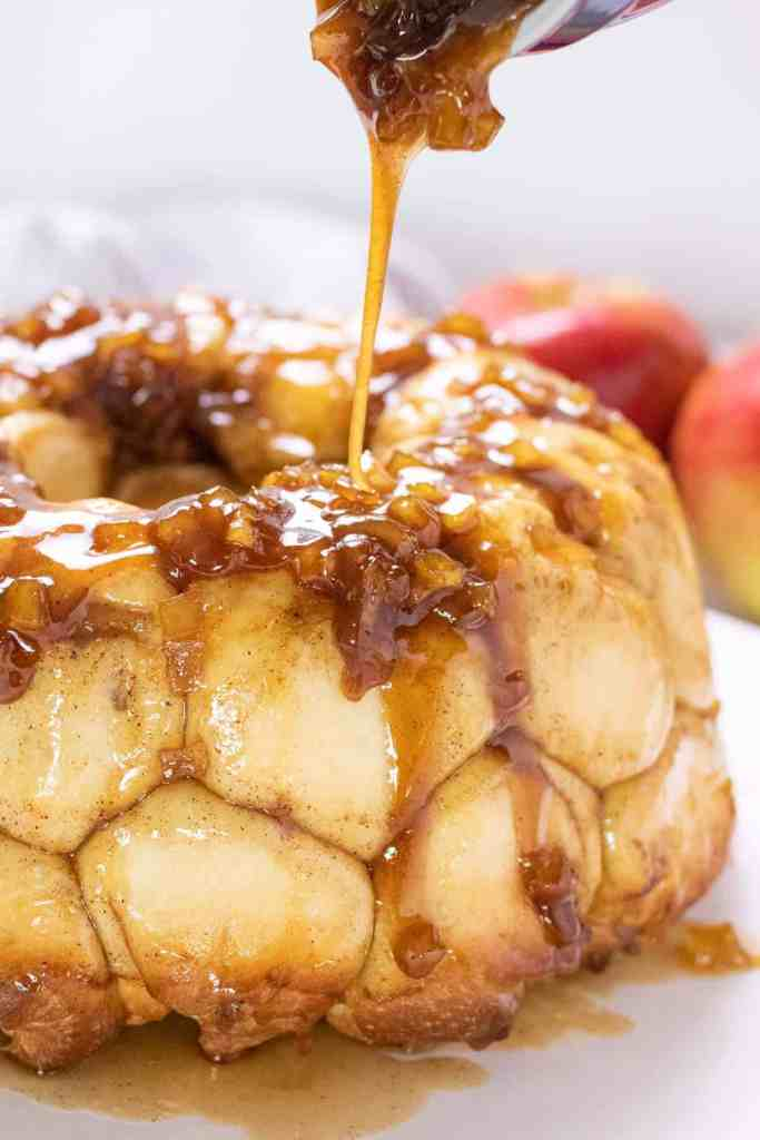 pouring the sticky apple topping onto the cooked monkey bread