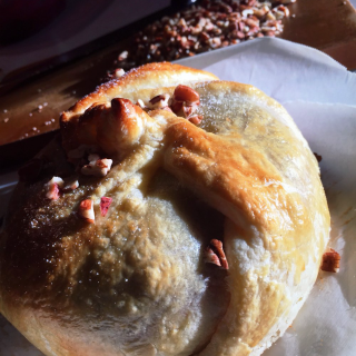 Holiday baked brie & rosemary-infused cranberry sauce topped with sugar and pecans