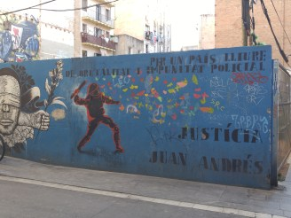 """A mural where an man named Juan Andrés Benitez was shot by police. It says """"For a country free from police brutality and impunity"""""""