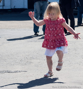 3-year-old Chloe Kelbie dances to the tune of a piper at Caol Ila's open day during the 2010 Islay Festival.
