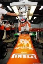 Paul Di Resta climbs out of the 2013 Sahara Force India F1 car during practice for the Indian Grand Prix in October, 2013. Image courtesy Sahara Force India.
