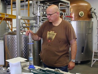 Dad's Hat co-founder Herman Mihalich tests a spirit run at the distillery on August 23, 2013. Image ©2013 by Mark Gillespie.