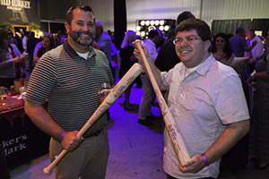 WhiskyCast listeners Sean and Michael display their autographed custom Louisville Slugger bats during the Kentucky Bourbon Festival September 17, 2014. Photo ©2014 by Mark Gillespie.