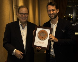 Canadian Whisky Awards founder Davin de Kergommeaux presents the Canadian Whisky of the Year Award to Brown-Forman's Chase Stampe February 15, 2015. Photo ©2015 by Mark Gillespie.