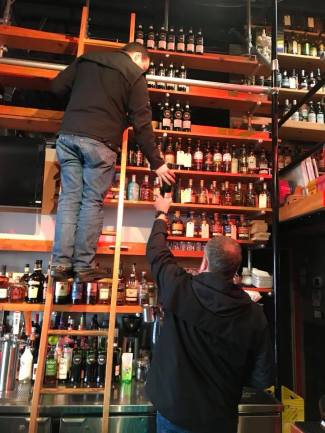 British Columbia Liquor Control & Licensing Branch agents seize Scotch Malt Whisky Society bottles from Fets Whisky Kitchen in Vancouver January 18, 2018. Photo courtesy Fets Whisky Kitchen.