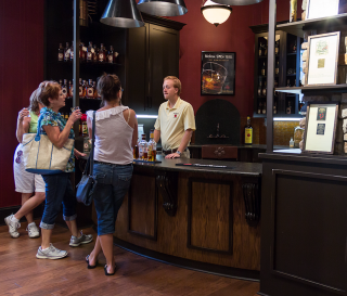 A Four Roses Distillery bartender talks with guests at the distillery's visitors center. File photo ©2018, Mark Gillespie/CaskStrength Media.