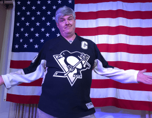 WhiskyCast's Mark Gillespie pays off a bet by wearing a Pittsburgh Penguins jersey during our special live event in Pittsburgh November 26, 2018.