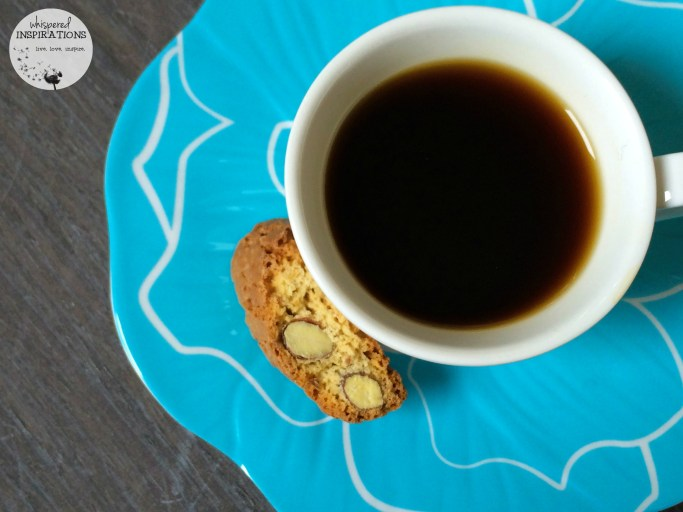 Black coffee with biscotti, made with compatible pods.