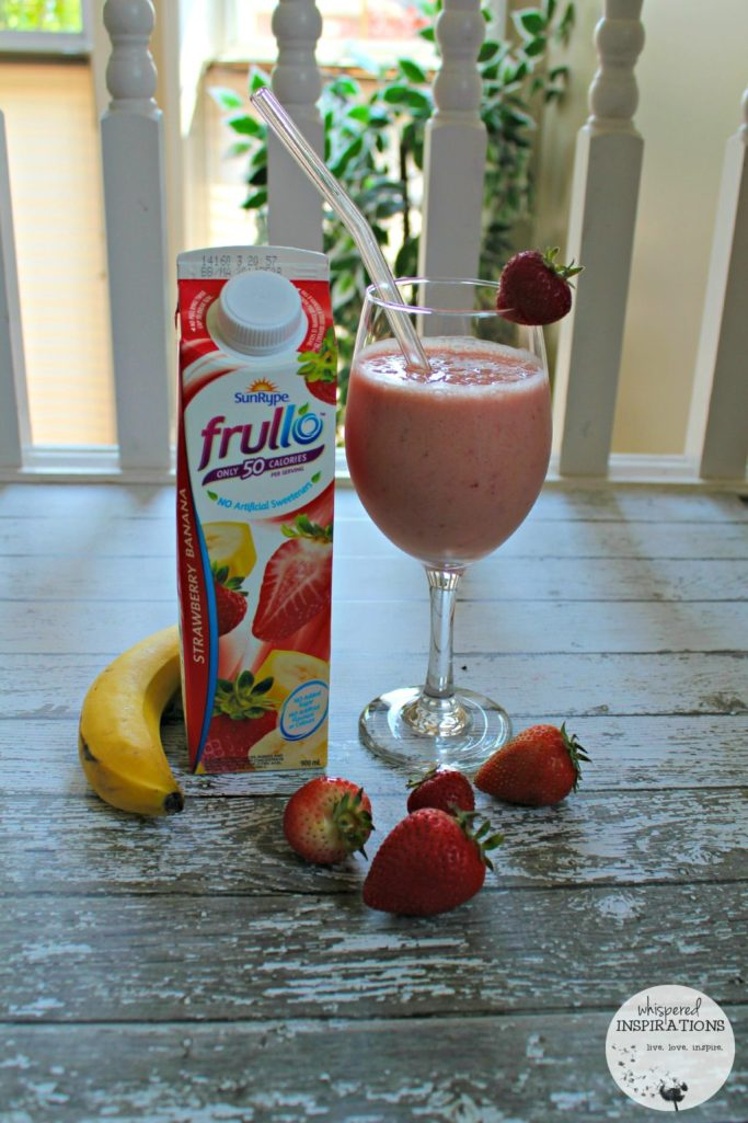 A carton of SunRype frullo with fresh banana and strawberries and smoothie.