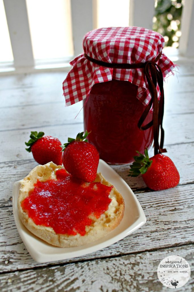 Another view of the strawberry jam on a buttered English muffin.