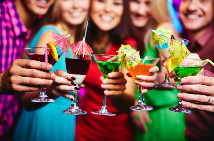 A group of girls hold cocktails and throw a Valentine's Day Cocktail Party!