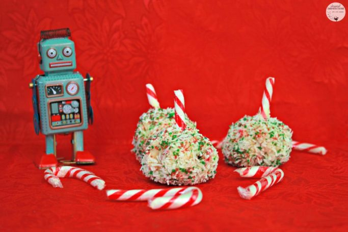 An old-school robot toy is standing next to the bite-size Rice Krispies treat.