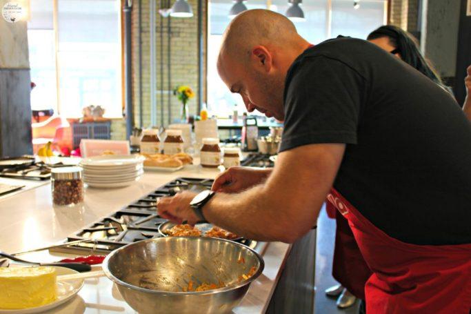 A chef prepares latkes with Nutella.