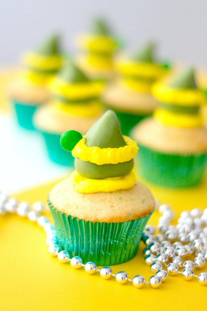 """Elf hat with added yellow buttercream stripe and """"feather"""" made with a green M&M."""